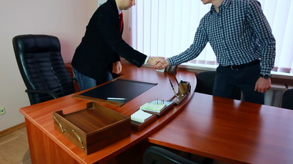 manager with business partner shaking hands and starting debates