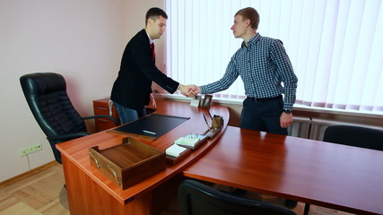 manager with business partner shaking hands and starting discuss
