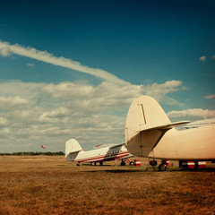 Planes stand in the autumn field.