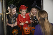 Obrazy na płótnie, fototapety, zdjęcia, fotoobrazy drukowane : Halloween Party With Children Trick Or Treating In Costume