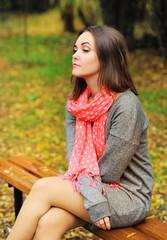 Sad woman portrait sitting on a bench.