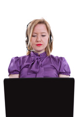 Businesswoman talking on headset with computer