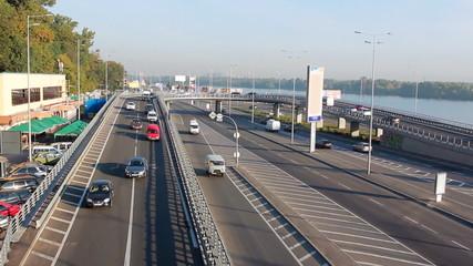 car traffic through overpass at sunny day, Kiev, Ukraine