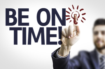 Business man pointing the text: Be on Time