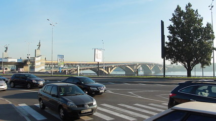 car traffic through pedestrian crossing near bridge on Dnieper
