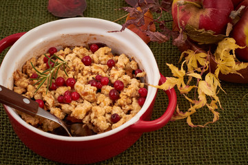 Apple crumble with cranberry and rosemary