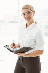 Businesswoman with diary in office