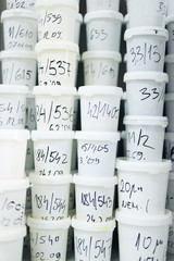 Numbers on White Plastic Buckets