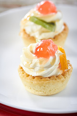 Small fruit tart with vanilla frosting