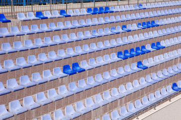 Rows of  light and dark  blue plastic stadium seats