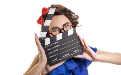 Woman with movie clapper board isolated on white