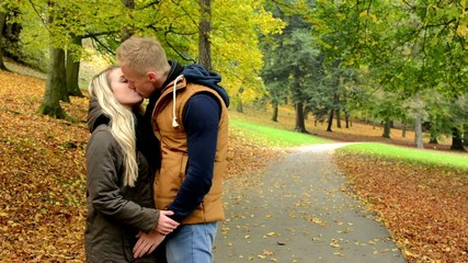 young model happy couple in love - couple kiss - autumn park