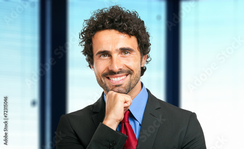 Leinwandbild Motiv Friendly businessman portrait