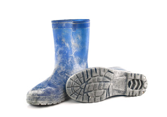 dirty rubber boots isolated on white background