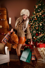 Pretty woman with many presents after Christmas shopping