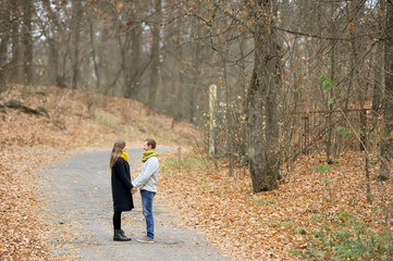 Pair of loving hearts walk in the autumn park
