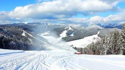 nice winter mountains, snow gun shoots, sideways moving ski lift