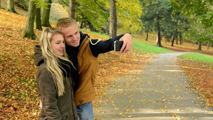 couple are photographing by smartphone (selfie) - happy couple