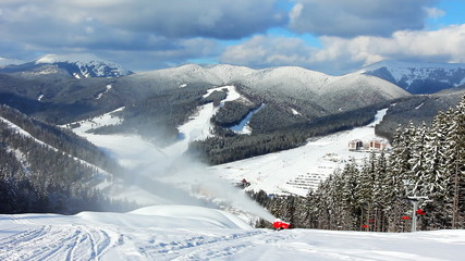 snow gun shoots, sideways moving ski lifts, timelapse
