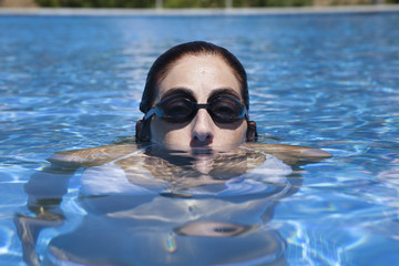 woman swimmer peering out of water