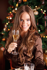 Beautiful young woman make a toast with a glass of champagne