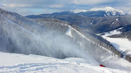 snow gun shoots in beautiful Carpathian Mountains, winter