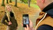 happy couple in love - man photographing woman with smartphone