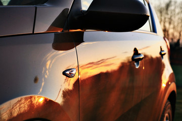 car sunset reflection