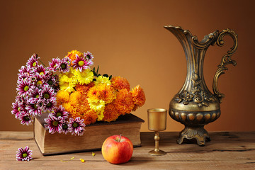Flowers and a metal jug