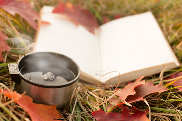 Vacuum flask cup and book
