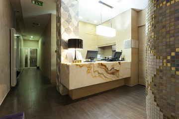 Reception area with marble reception desk