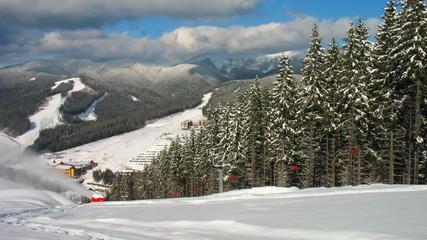 beautiful winter mountains, sideways snow gun shoots, timelapse