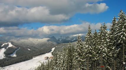beautiful winter mountains, beneath moving ski lifts, timelapse