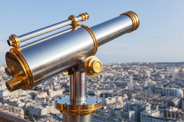 Telescope mounted on the railings of Eiffel Tower in Paris