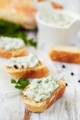 Greek appetizer(tzatziki) on a slice of bread