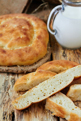 Homemade flat bread with sesame and milk