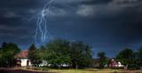 Lightning storm over village - 72328487