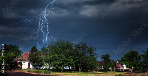 Lightning storm over village