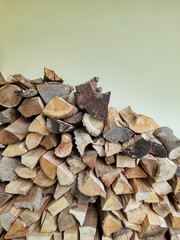 Stacked logs firewood, natural pattern background