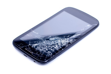 black mobile phone with a broken screen on an isolated backgroun