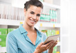 Smiling woman with tablet at supermarket