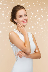 smiling woman in white dress with diamond ring