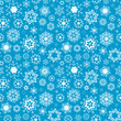 Blue vector winter background with snowflakes. Seamless pattern.