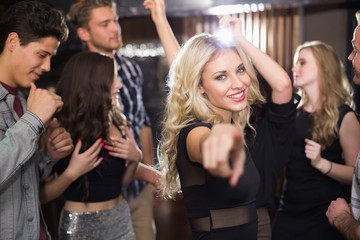 Stylish blonde smiling at camera