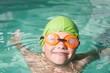 Cute kid swimming in the pool
