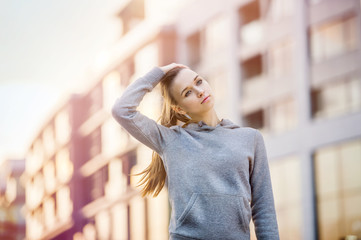 Woman stretching in city