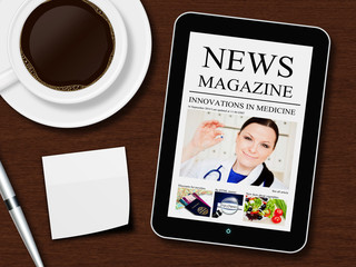 tablet with news magazine, cup of coffee, pen and white sheet