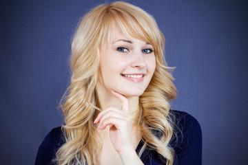 Headshot beautiful smiling girl isolated on dark blue background