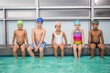 Cute swimming class smiling at camera - 72333674