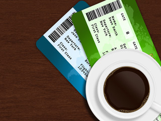 cup of coffee with airplane tickets lying on wooden table